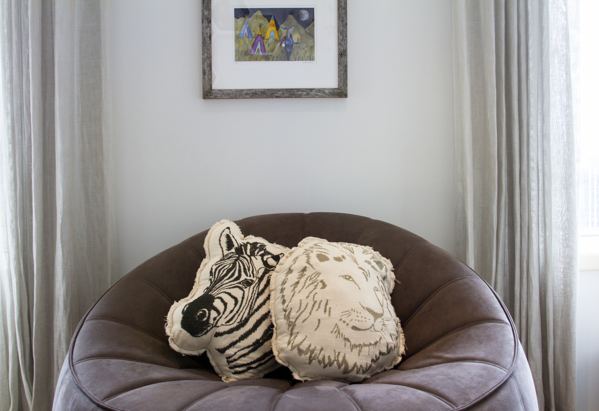 Lions & zebras & comfy seating, oh my! The perfect way to combine creativity with comfort in your nursery for baby boy. Designed by Havenly.