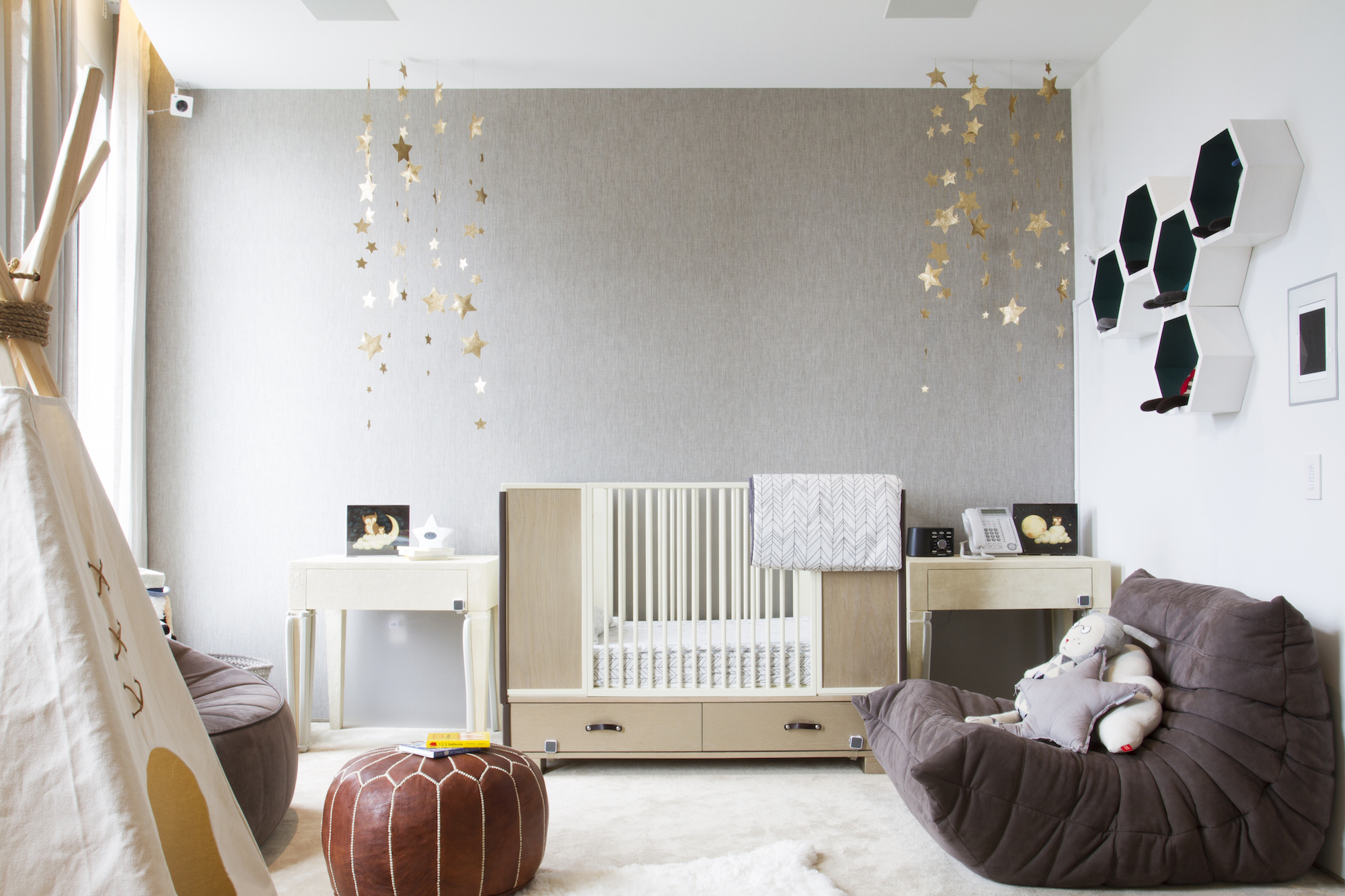 Who wouldn't love their own teepee? A playful nursery for baby boy, designed by Havenly.