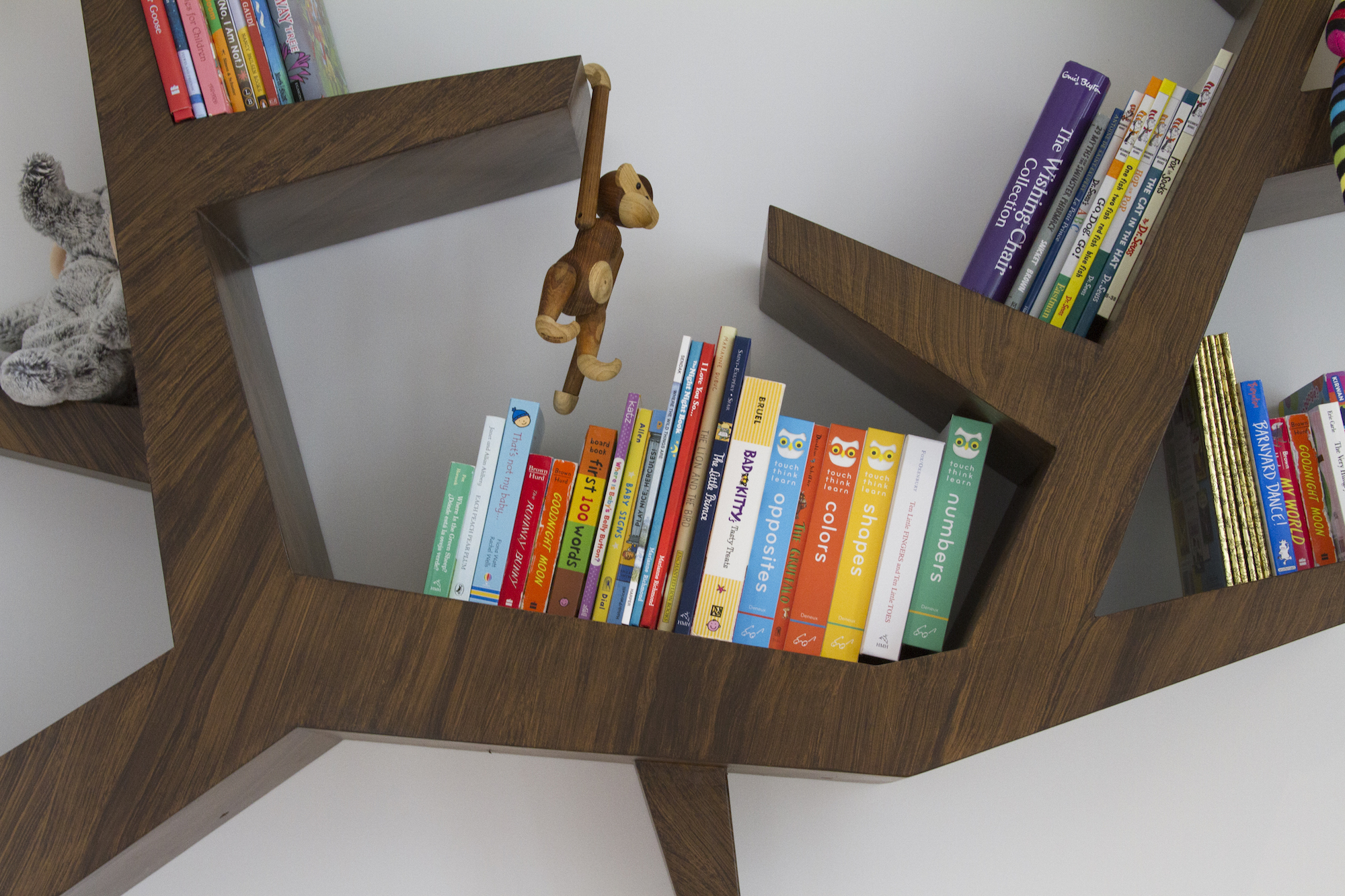 A branch book shelf! A creative way to display your books in your baby boy nursery. Designed by Havenly.