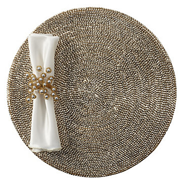 Can you say glam?! We LOVE these studded placemats. See more of Havenly's favorite studded pieces.