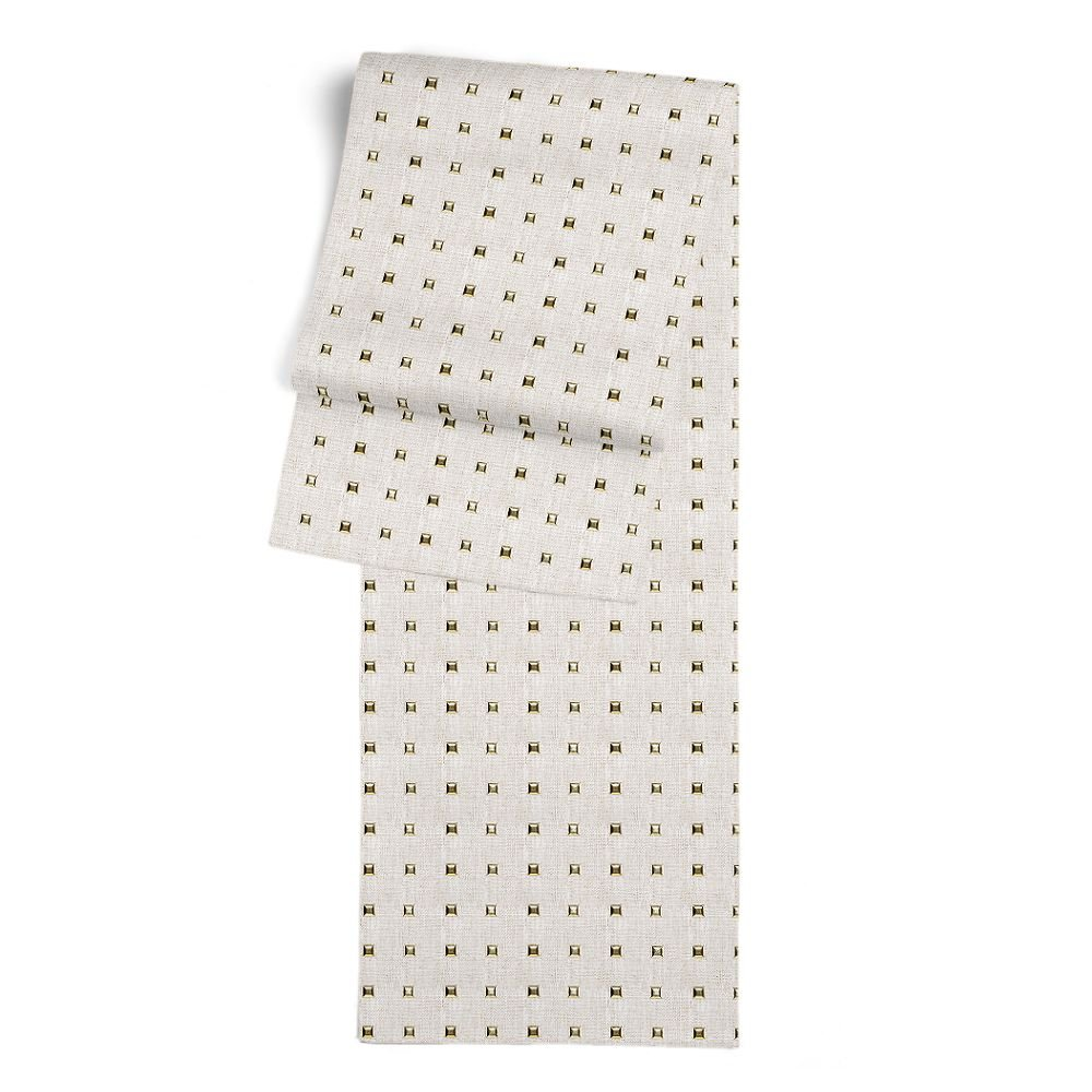 Add glam to your table with this studded table runner! See more of Havenly's favorite studded pieces.