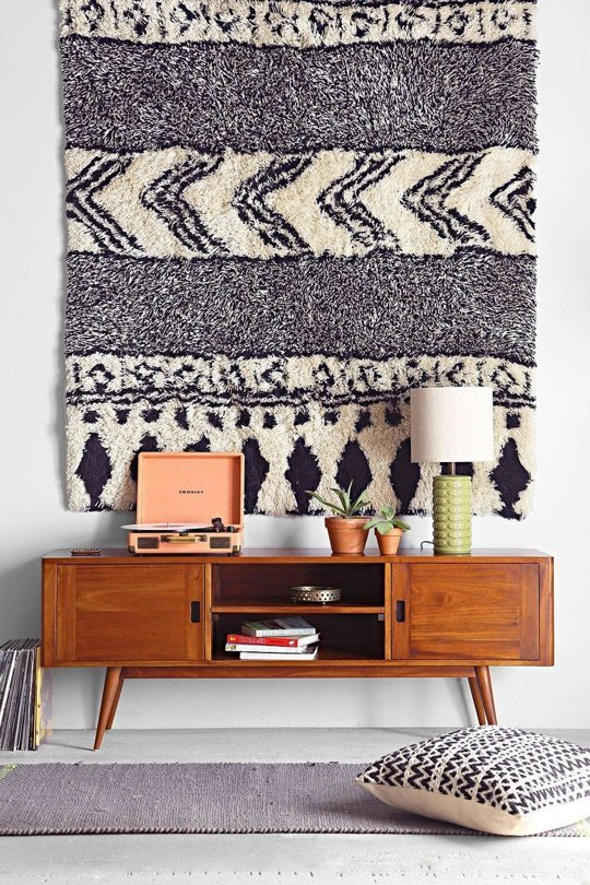 One way to absorb noise is by using plush rugs and heavier fabrics – a great tip for studio apartment design ideas!