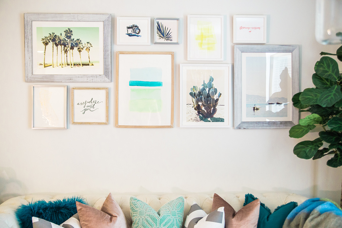 Breath creativity into your living room design ideas with a gallery art wall.