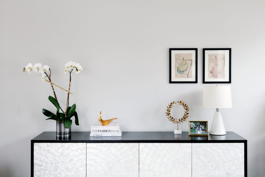 Best Smelling Flowers for your space - orchid on a desk or vanity