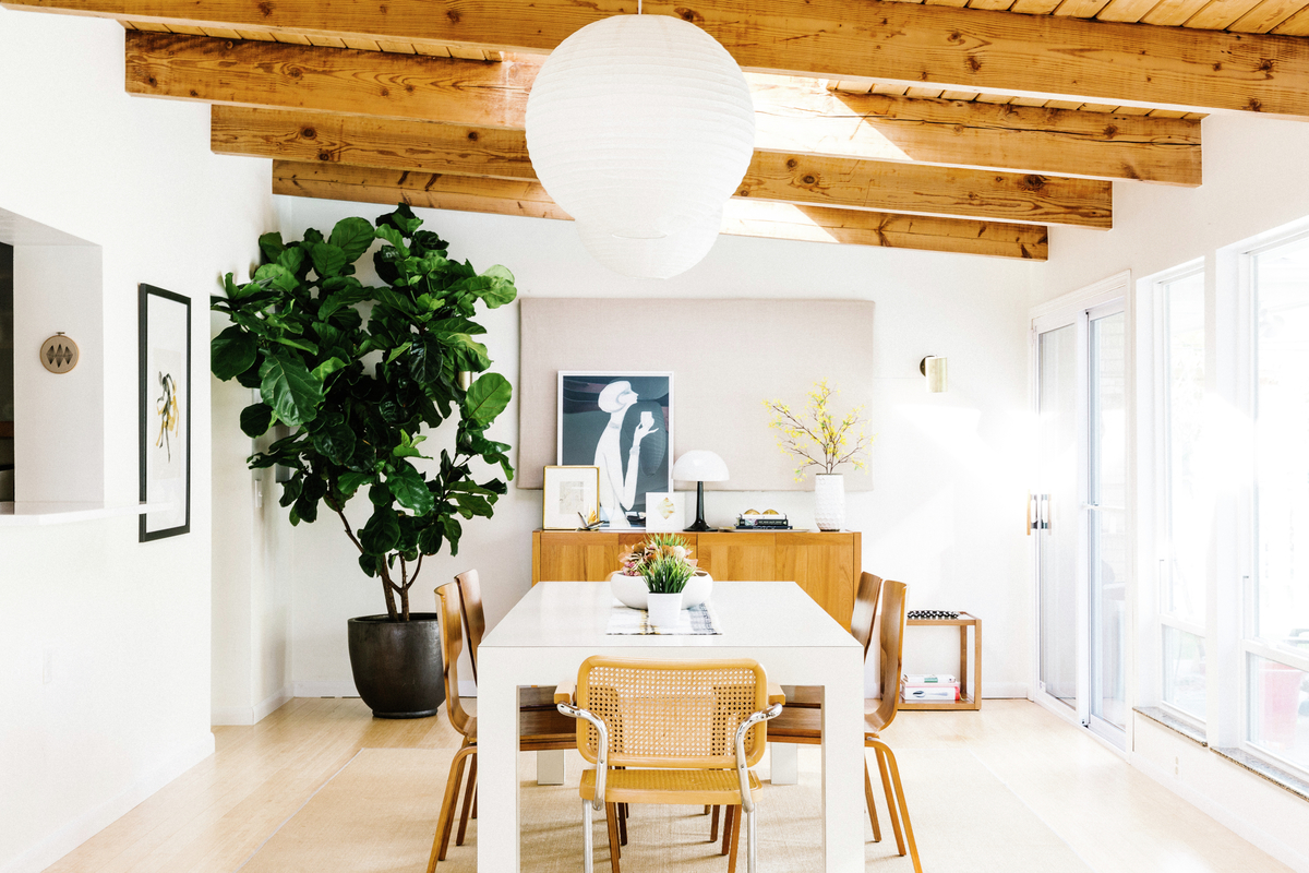 Molly Bevan's mid-century modern home sunroom with wooden beams