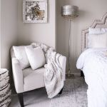 blush pink bedroom -- chair and cozy throw