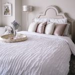 blush pink bedroom design -- guest bedroom with gold foil pillows